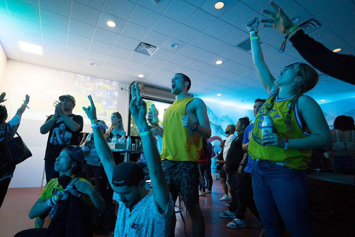 Warriors fans cheer while watching the NBA playoffs at the BottleRock Music Festival in Napa, Calif. on Saturday, May 26, 2018.