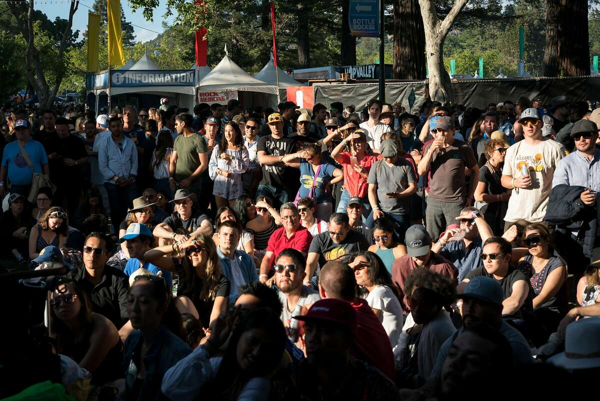People gather to watch the warriors playoff game at the BottleRock Music Festival in Napa, Calif. on Saturday, May 26, 2018.