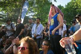 """Scott Olofson cheers for the warriors while watching the playoff game at the BottleRock Music Festival in Napa, Calif. on Saturday, May 26, 2018.  Olofson said he was feeling """"stressed out"""" while watching."""