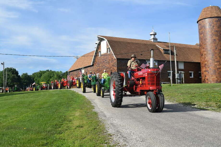 "Prairie Land Heritage Museum held its second annual Tractor Cruise Saturday. Around 50 antique tractors left from the farm museum in South Jacksonville on a 35-mile drive through Morgan and Scott counties. ""It's just something we do for a good time,"" event organizer Dale Lair of rural Ashland said. Photo:     Greg Olson 