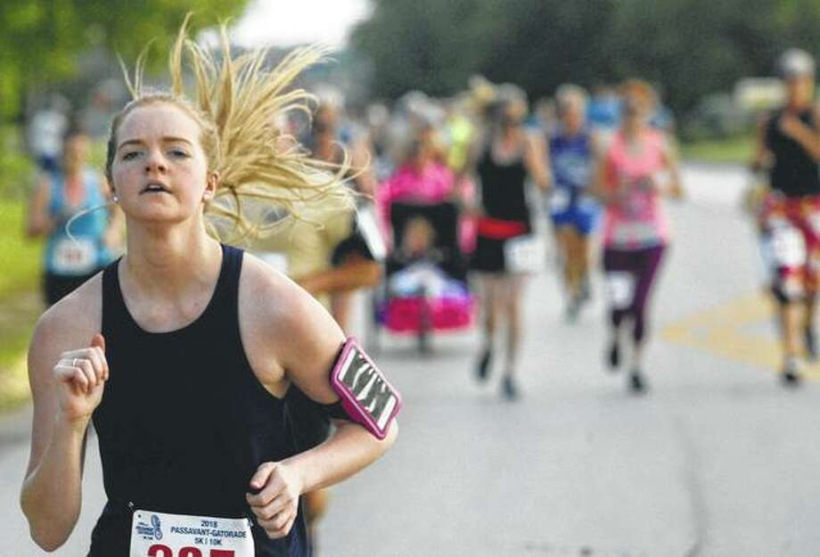 Emma Stuhmer focuses on the road ahead during Saturday's Passavant-Gatorade 5K-10K Race sponsored by the Passavant Area Hospital Foundation. The race, which is the longest consecutively run race in Jacksonville and marking its 26th year, drew about 300 runners. Stuhmer ended the 5K portion of the race with a time of 27:20, putting her fourth in the 20-24 age group. Photo:       David C.L. Bauer | Journal-Courier