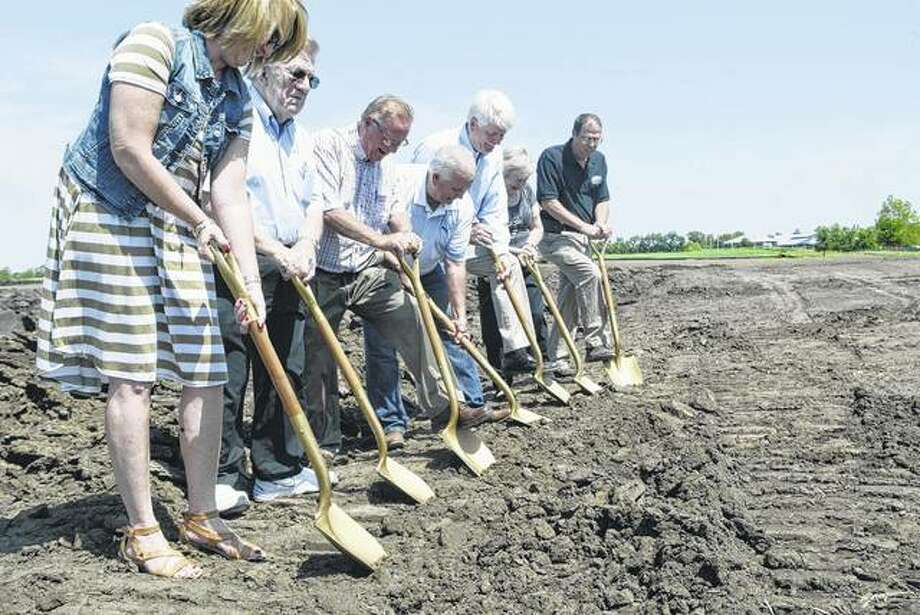 Several Virginia and Cass County officials and an aide to U.S. Rep. Darin LaHood attended a ground breaking Thursday for a new affordable housing project in Virginia. Using the ceremonial gold shovels are Cass County Clerk Shelly Wessel (from left) Cass County Board Chairman Dave Parish, Cass County Housing Authority Board Chairman Laymon Carter, Virginia Mayor Reg Brunk, Windsor Development Group President Mike Niehaus, Cass County Board member Joyce Brannan and Cass County Housing Authority Executive Director Steve Horton. Photo:       Greg Olson | Journal-Courier