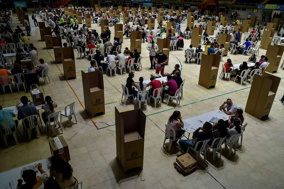 Residents of Cali vote in Colombia's first presidential election since the signing of a historic peace accord. Photo: Luis Robayo / AFP / Getty Images