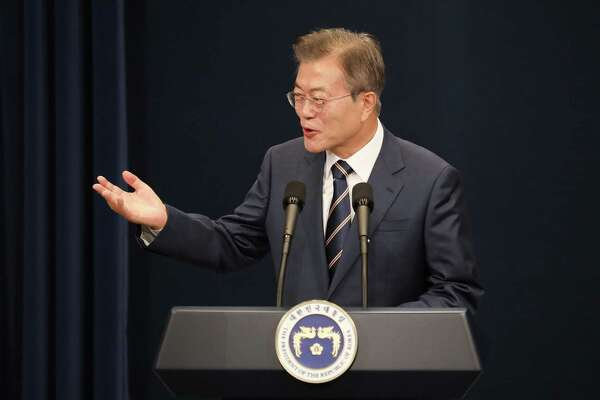 Moon Jae-in, South Korea's president, speaks during a news conference at the presidential Blue House in Seoul on Sunday.