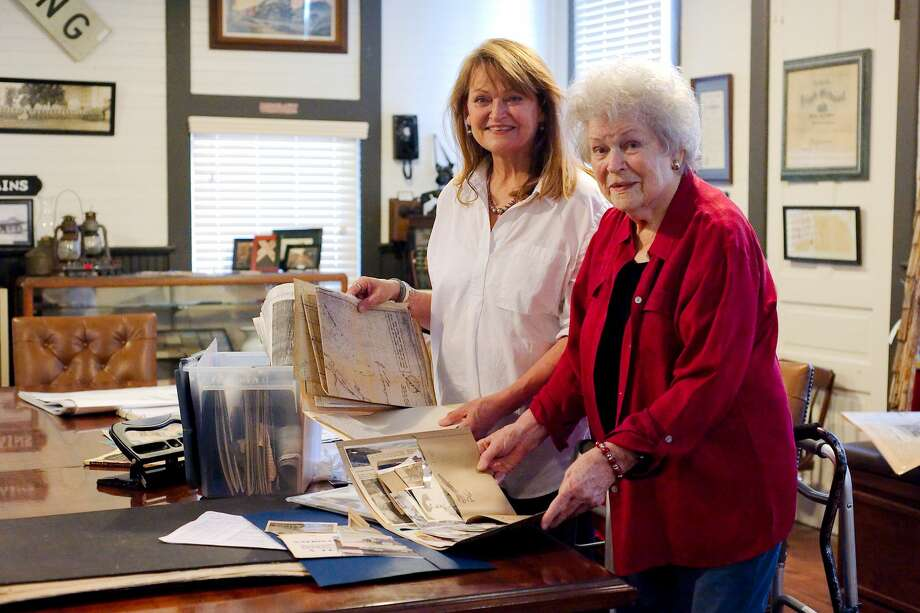 La Porte Bay Area Heritage Society museum docent Georgia Malone and her mother, Heritage Society archivist and author Ann Malone examine, a folder of vintage photographs at the La Porte Bay Area Heritage Society Depot Museum Saturday, May 26. Photo: Kirk Sides/Houston Chronicle