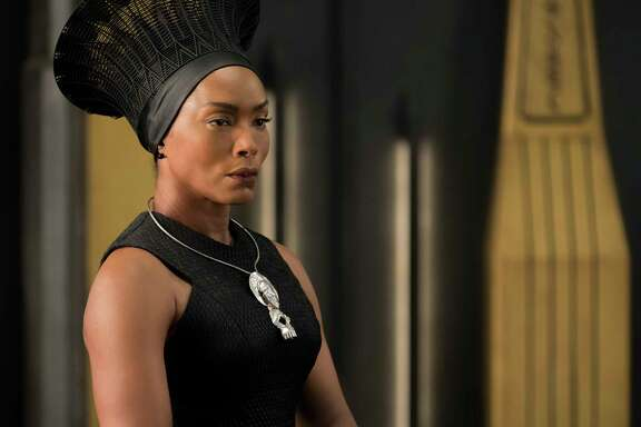 "This image released by Disney -Marvel Studios shows, Angela Bassett in a scene from ""Black Panther."" Danai Gurira says the representation of women in ""Black Panther"" is important for young girls to see. The film features a number of powerful female leads, including Gurira as the head of a special forces unit, Lupita Nyong'o as a spy, Bassett as the Queen Mother and newcomer Letitia Wright as a scientist and inventor.  (Matt Kennedy/Disney/Marvel Studios via AP)"