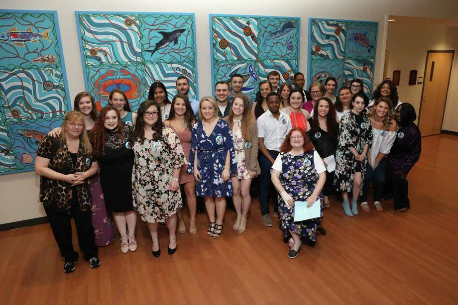 Social work majors at Eastern Connecticut State University are inducted into its chapter of Phi Alpha, the national social work honor society. Photo: Contributed /