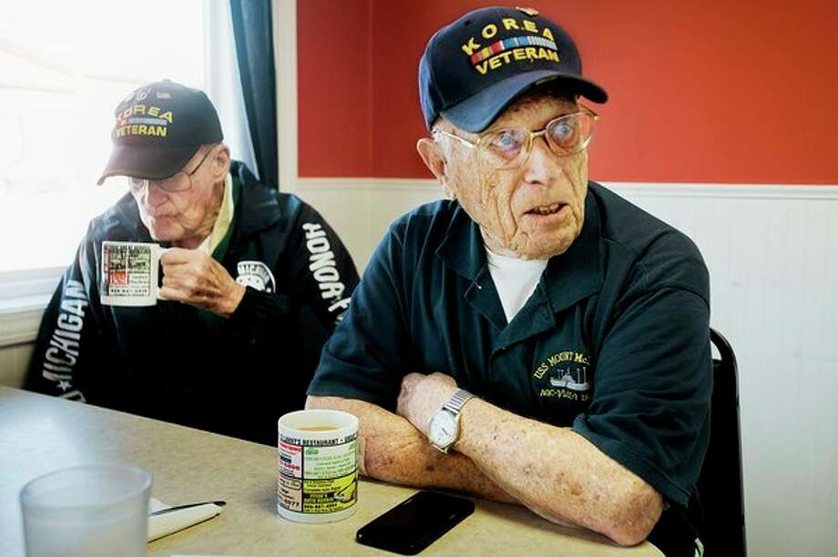 Patrick Tracy, right, and Jack Whitehouse, left, talk about their experience last week on the Mid-Michigan Honor Flight to Washington D.C. while enjoying coffee at Lanny's Restaurant on Thursday morning. (Katy Kildee/kkildee@mdn.net)