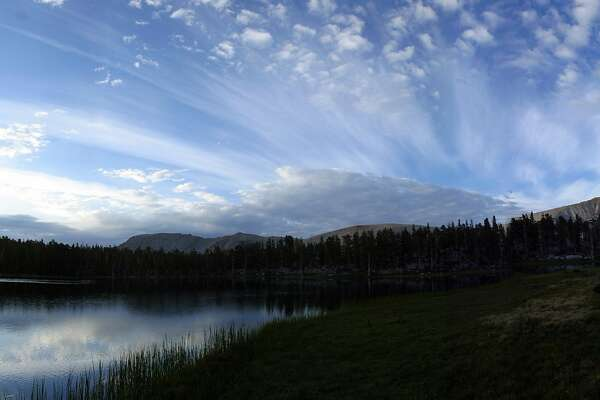 At Forester Lake, set at 10,354 feet on the eastern edge of the Great Western Divide: At dusk, a cut-off low from a distant typhoon and clouds from both local events and monsoonal flows merged into a kaleidoscope sky of cirrus, cumulus and distant stratus At sunset, a mix of alto cirrus with mare�s tails and cumulus provide a backdrop to pristine Forester Lake at 10, 240 feet, nestled in the Great Western Divide. Photo by Michael Furniss / Special to the Chronicle