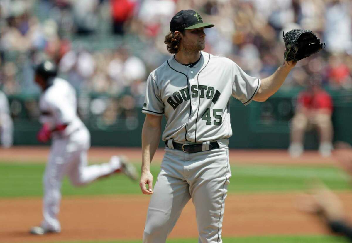 Houston Astros starting pitcher Gerrit Cole waits for a ball as Cleveland Indians' Jose Ramirez runs the bases after Ramirez hit a two-run home run in the first inning of a baseball game, Sunday, May 27, 2018, in Cleveland. (AP Photo/Tony Dejak)