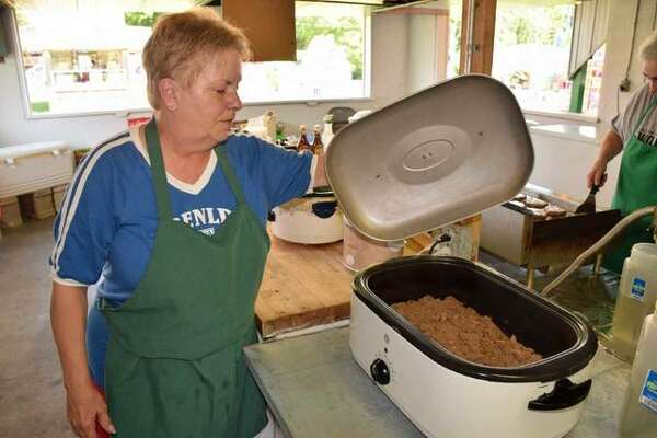 Crystal Calvert checks the Italian beef while it's cooking at the 65th Annual Italian-American Days Festival in Benld.