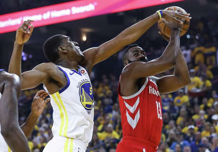 Golden State Warriors forward Kevon Looney (5) reaches out to defend a shot by Houston Rockets guard James Harden (13) during the first half of Game 6 of the NBA Western Conference Finals at Oracle Arena, Saturday, May 26, 2018, in Oakland.  ( Karen Warren  / Houston Chronicle ) Photo: Karen Warren, Staff / Houston Chronicle / © 2018 Houston Chronicle