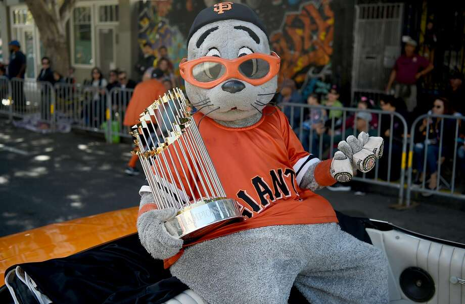 Giants mascot Lou Seal holds the championship trophy during the Carnival parade in San Francisco on May 27, 2018. Photo: JOSH EDELSON / JOSH EDELSON / SAN FRANCISCO CHRONICLE