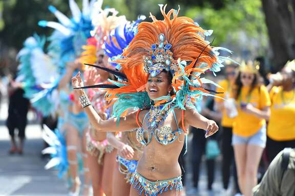 Participants dance during theCarnavalparade as it travels through the mission district of San Francisco on Sunday, May 27, 2018.