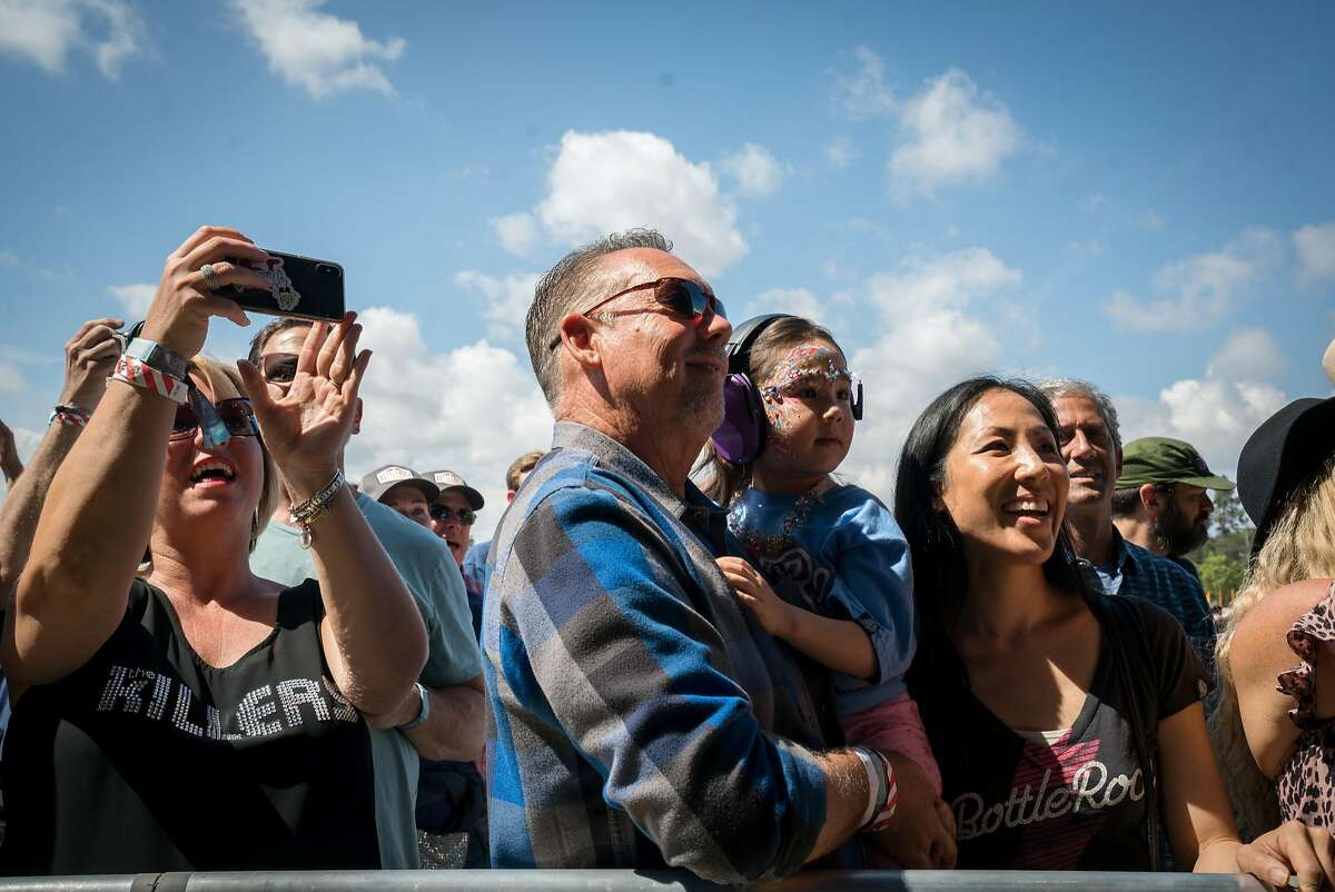 People watch Michael Franti's set at the BottleRock Music Festival in Napa, Calif. on Saturday, May 26, 2018.