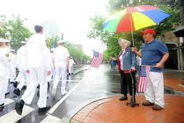 Mary Blanco and her son Louis Blanco cheer the U.S. Naval Sea Cadet Corps during the annual Memorial Day parade in downtown Stamford, Conn. on Sunday, May 27, 2018.