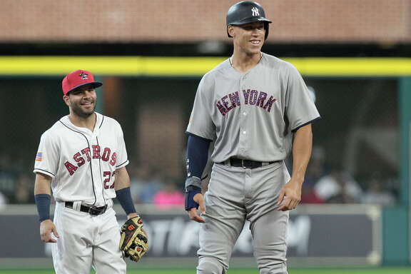 New York Yankees' Aaron Judge, right, and Houston Astros second baseman Jose Altuve have a conversation during the first inning of a baseball game, Sunday, July 2, 2017, in Houston. Both players have been elected to start in the All-Star Game in Miami on July 12, 2017.  (Yi-Chin Lee/Houston Chronicle via AP)