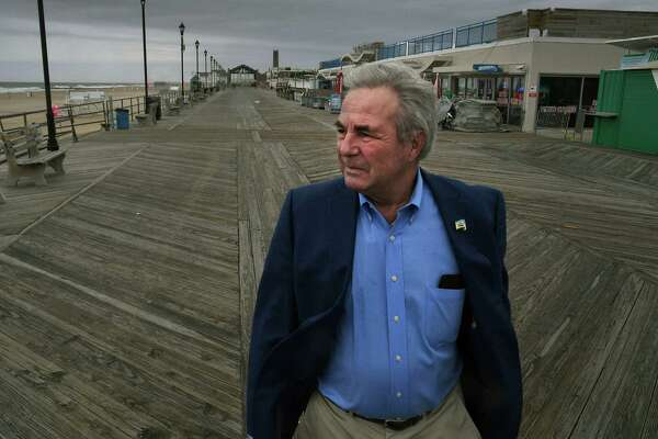Asbury Park Mayor John Moor walks on the city's boardwalk. He was among those who lobbied for a state law that prohibits oil exploration in waters up to 3 miles from shore and bucks the Trump administration's push.