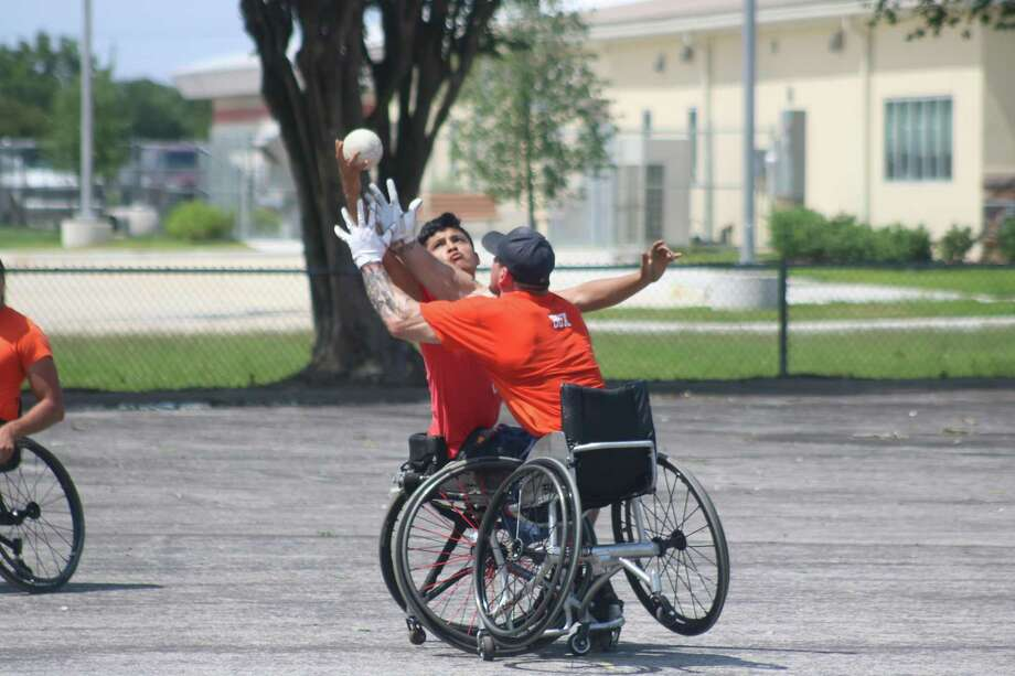 Rollin' Astros centerfielder Zach Ruhl and his centerfielder collide going after a ball during Sunday afternoon's championship game of the Wheelchair Wind-up. Photo: Robert Avery