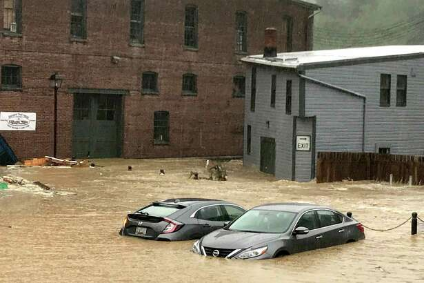 Two vehicles in historic Ellicott City, Md., as flood waters raged through the streets following torrential thunderstorms.