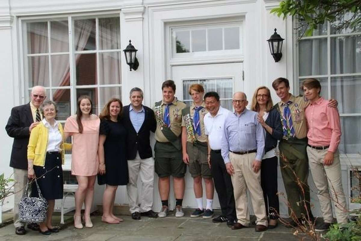 New Eagle Scouts Leo Johnson (center, left) and Will Graney Green (center, right) are joined by Sen. Tony Hwang (fifth from right) and their parents, grandparents, and siblings in celebrating their Court of Honor.