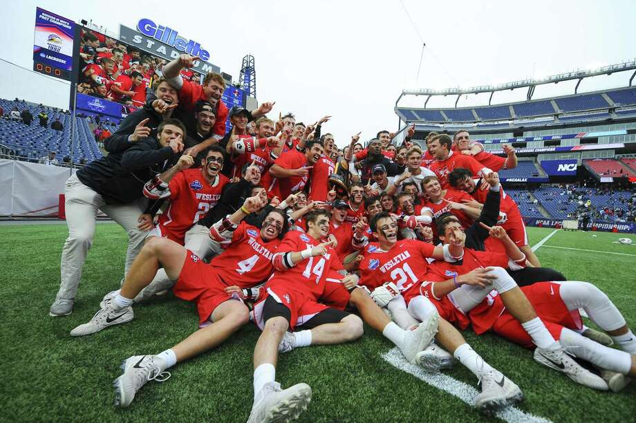 The Wesleyan men's lacrosse team defeated Salisbury 8-6 Sunday at Gillette Stadium in Foxborough, Mass. to win its first national championship. Photo: Steve McLaughlin / Wesleyan University
