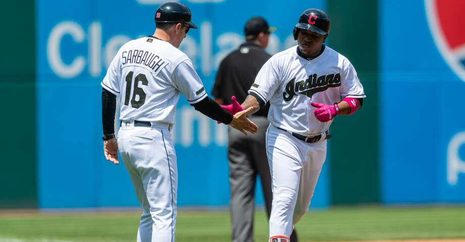 CLEVELAND, OH - MAY 27: Jose Ramirez #11 of the Cleveland Indians slaps hands with third base coach Mike Sarbaugh #16 after hitting a two-run home run during the first inning against the Houston Astros at Progressive Field on May 27, 2018 in Cleveland, Ohio. (Photo by Jason Miller/Getty Images) Photo: Jason Miller/Getty Images
