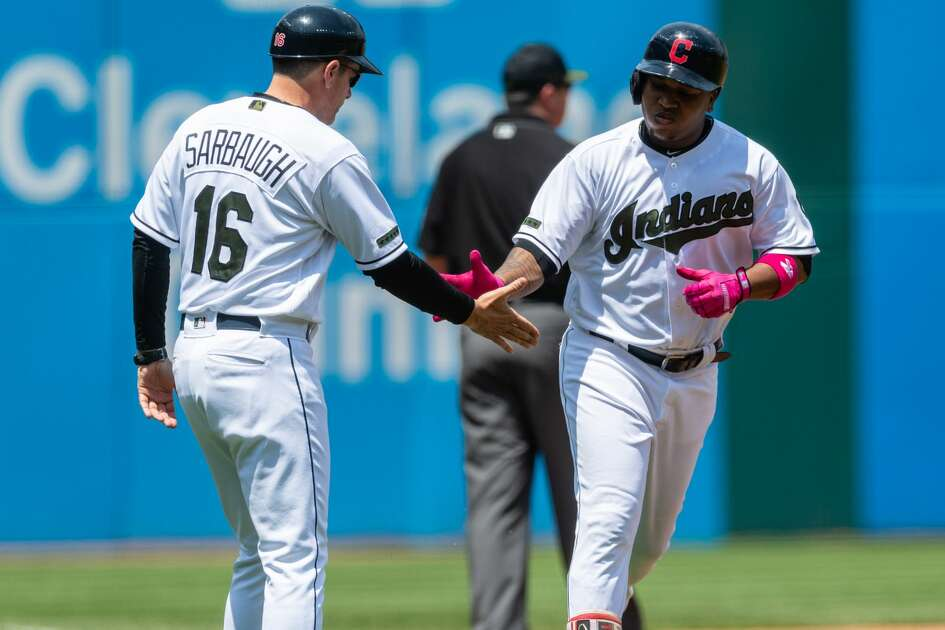 CLEVELAND, OH - MAY 27: Jose Ramirez #11 of the Cleveland Indians slaps hands with third base coach Mike Sarbaugh #16 after hitting a two-run home run during the first inning against the Houston Astros at Progressive Field on May 27, 2018 in Cleveland, Ohio. (Photo by Jason Miller/Getty Images)