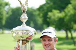 Justin Rose, of England, poses for a photo with the trophy after winning the Fort Worth Invitational golf tournament at Colonial Country Club in Fort Worth, Texas, Sunday, May 27, 2018. (AP Photo/Cooper Neill)