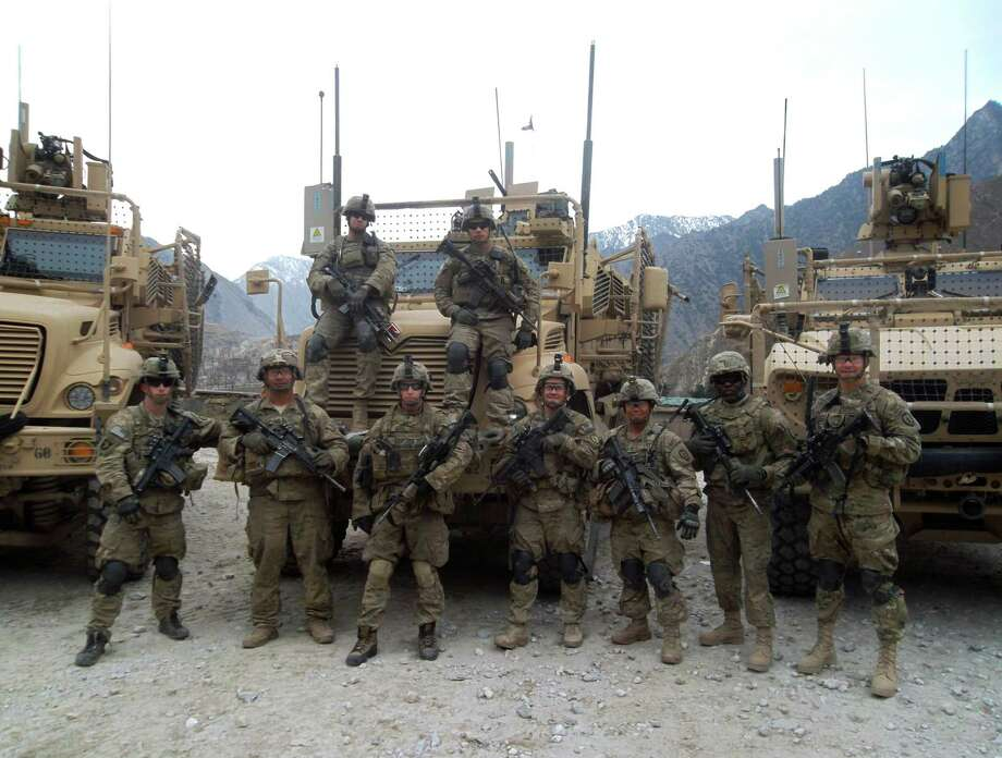 2nd Lt. Clovis Ray, far right, stands with his men at a base in Kunar province, Afghanistan Photo: Photos Courtesy Of Ed Ray / COPYRIGHT,2011