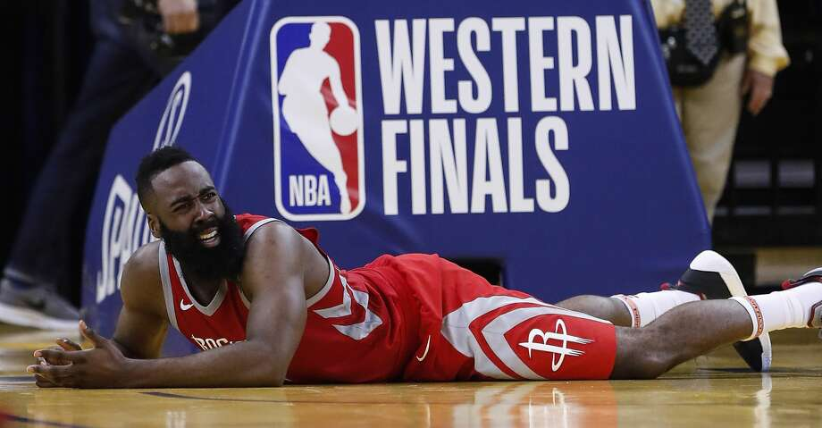 Houston Rockets guard James Harden (13) lies on the court during the fourth quarter of Game 6 of the NBA Western Conference Finals against the Golden State Warriors at Oracle Arena, Saturday, May 26, 2018, in Oakland.  ( Karen Warren  / Houston Chronicle ) Photo: Karen Warren/Houston Chronicle