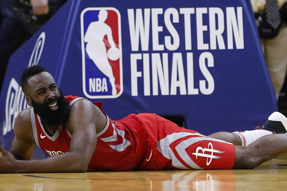 Houston Rockets guard James Harden (13) lies on the court during the fourth quarter of Game 6 of the NBA Western Conference Finals against the Golden State Warriors at Oracle Arena, Saturday, May 26, 2018, in Oakland.  ( Karen Warren  / Houston Chronicle )
