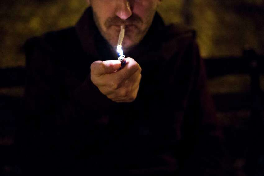 File - A man smokes marijuana in Tompkins Square Park in New York, Dec. 12, 2015. (Hilary Swift/The New York Times)