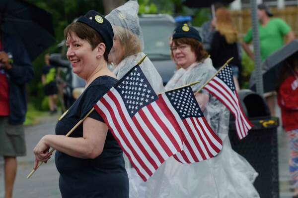 Members of American Legion Auxiliary Gerald O'Neil Unit 1683 march in the Rensselaer Memorial Day Parade on Sunday, May 27, 2018, in Rensselaer, N.Y.  (Paul Buckowski/Times Union)