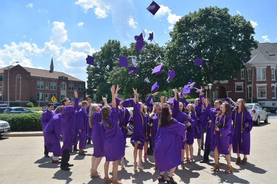 Routt's class of 2018 celebrates their graduation by throwing their caps into the air. Photo:       Audrey Clayton | Journal-Courier