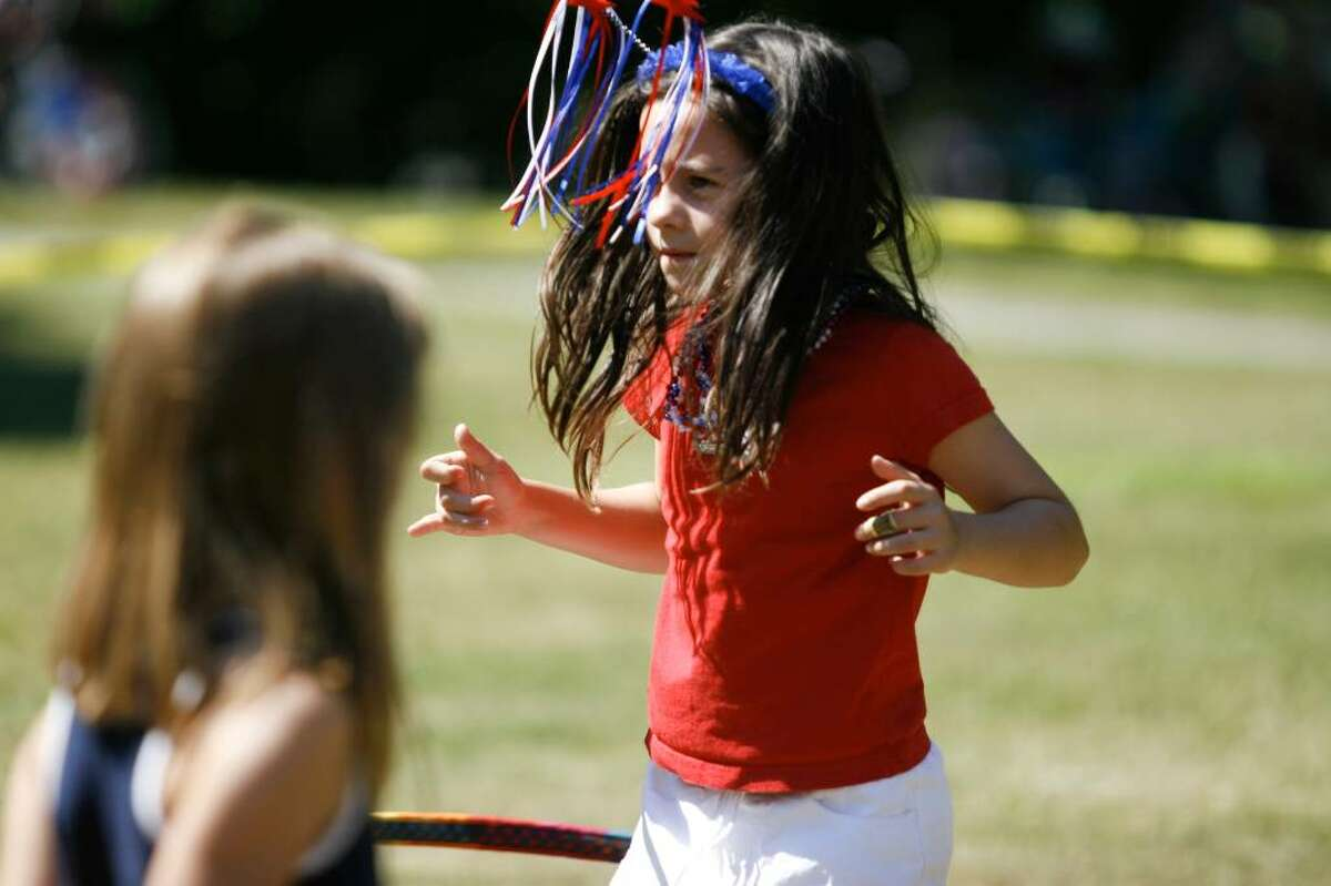 Kayla Thomson, age 7, practices hula-hooping at the Pequot Library's Independence Day festivities in Southport on Sunday, July 4, 2010.