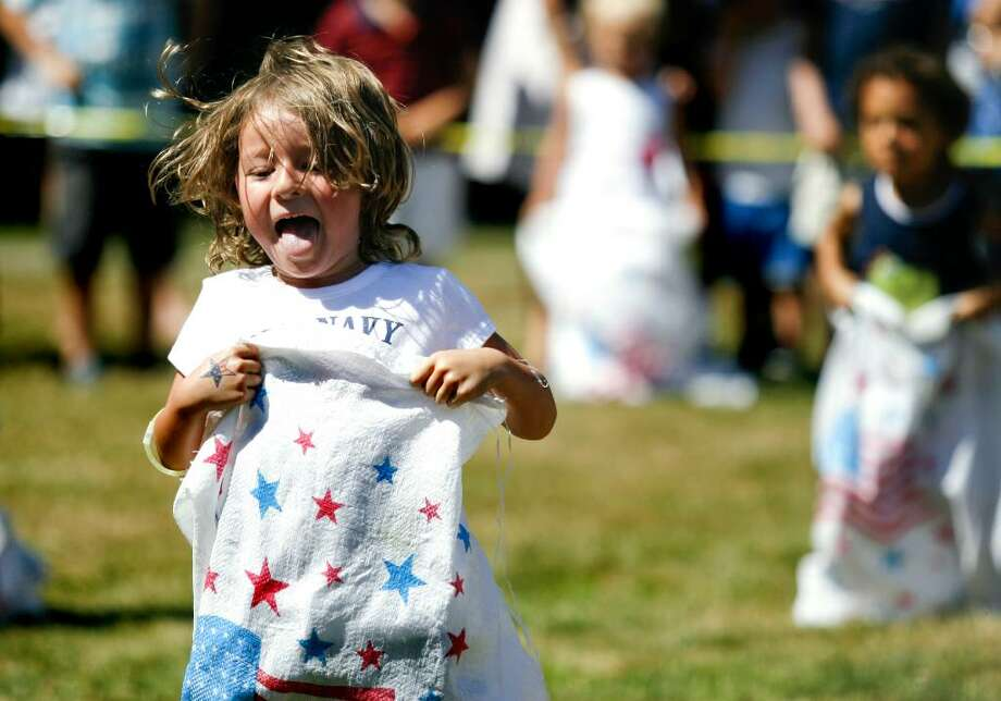 Tia Stapleton, age 4, participates in a sack race during the Pequot Library's Independence Day festivities in Southport on Sunday, July 4, 2010. Photo: Laura Buckman / Connecticut Post