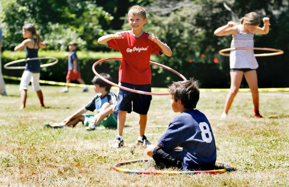 Jay Joliet, center, age 8, competes in a hula-hoop contest during the Pequot Library's Independence Day festivities in Southport on Sunday, July 4, 2010. Photo: Laura Buckman / Connecticut Post