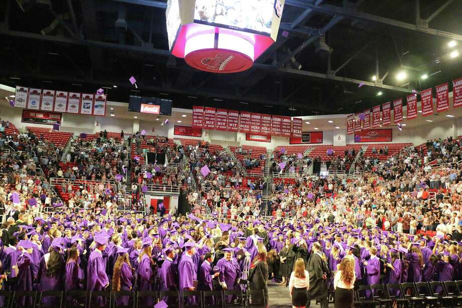 Students couldn't wait to toss their mortarboards after they received their diplomas at Dayton High School graduation ceremonies in the Montagne Center on the campus of Lamar University in Beaumont Saturday afternoon, May 26. Photo: David Taylor / HCN