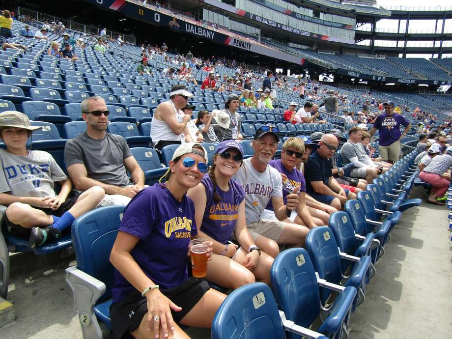 Photos from the UAlbany fan section during the men's lacrosse team's Final Four semifinal game against Yale at Gillette Stadium in Foxborough, Mass., on May 26, 2018. Photo: Michael Parker
