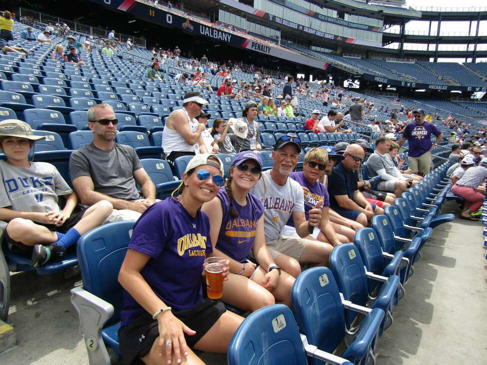 Photos from the UAlbany fan section during the men's lacrosse team's Final Four semifinal game against Yale at Gillette Stadium in Foxborough, Mass., on May 26, 2018.