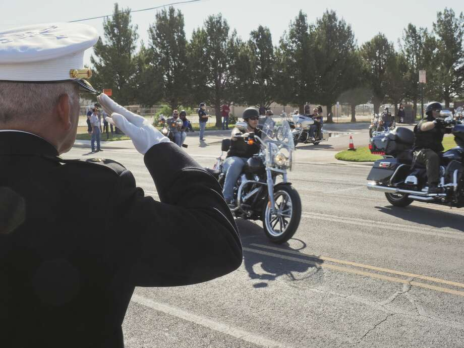 Ramon Armendariz, Ret. Major USMC, salutes riders as they leave 05/28/18 morning at the Vietnam Memorial in Midland to ride to Andrews to participate in another Memorial Day ceremony as part of the annual Ride to Remember. Tim Fischer/Reporter-Telegram Photo: Tim Fischer/Midland Reporter-Telegram