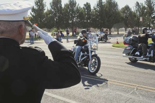 Ramon Armendariz, Ret. Major USMC, salutes riders as they leave 05/28/18 morning at the Vietnam Memorial in Midland to ride to Andrews to participate in another Memorial Day ceremony as part of the annual Ride to Remember. Tim Fischer/Reporter-Telegram
