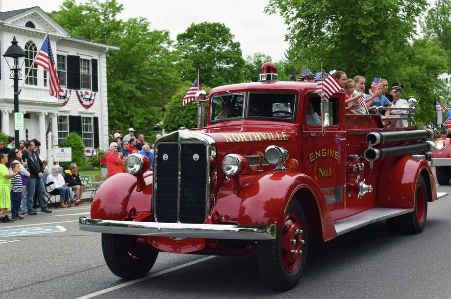 Spectrum/Children wave aboard a Northville Volunteer Fire Department truck participating in the New Milford Memorial Day parade may 28, 2018. Photo: Deborah Rose, Hearst Connecticut Media / The News-Times  / Spectrum