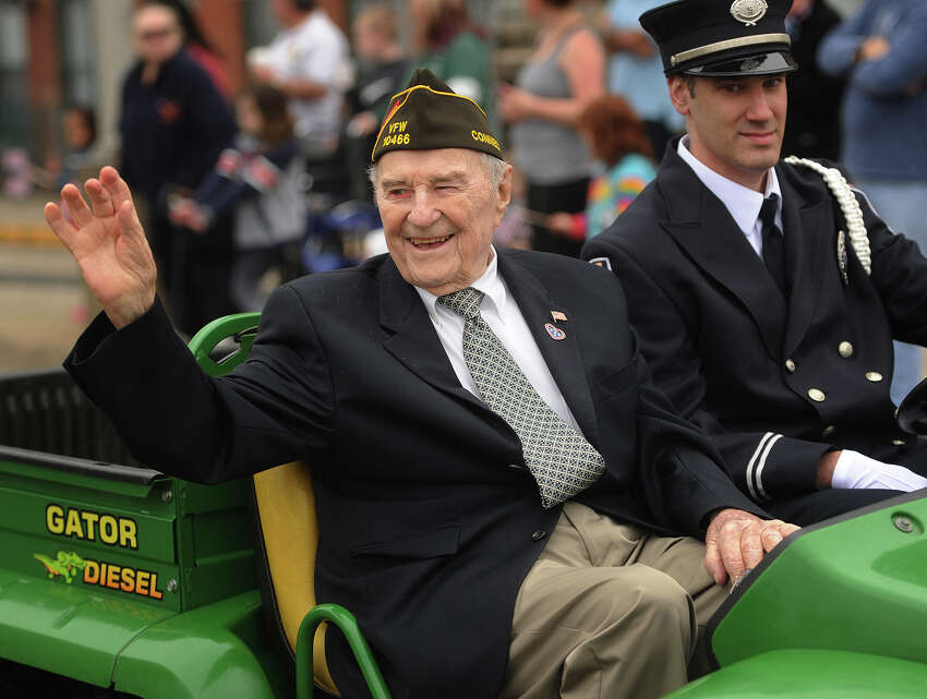 World War 2 veteran Roy Glover, of Shelton, waves as he rides in the annual Derby-Shelton Memorial Day Parade in Derby, Conn. on Monday, May 28, 2018.