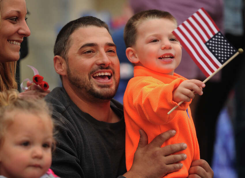 Amanda Juliano, Frank Juliano, and Frank Juliano IV, 3, of Oakville, cheer on the annual Derby-Shelton Memorial Day Parade on Elizabeth Street in Derby, Conn. on Monday, May 28, 2018.