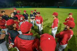 Stanford players get instructions from new head baseball coach David Esquer (8) before a intrasquad scrimmage at Stanford University on Friday, Jan. 26, 2018, in Stanford, California.