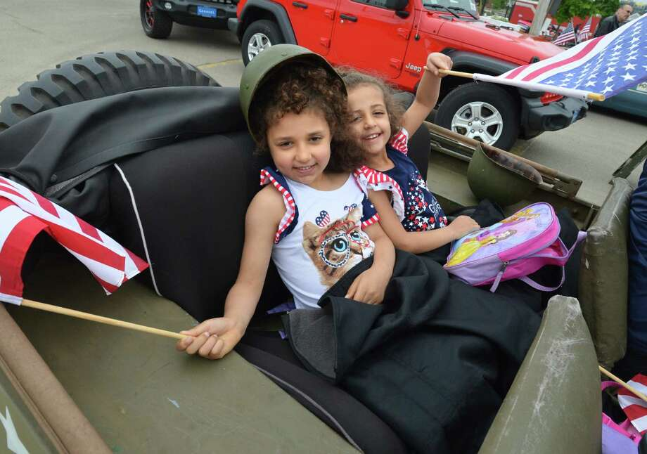6 year-old twins Aurora and Angelina McGuire with helmets on and flags in hand get ready in their dad's 1946 Willys army jeep for the Norwalk memorial day parade on Monday May 28, 2018 in Norwalk Conn. Photo: Alex Von Kleydorff, Hearst Connecticut Media / Norwalk Hour