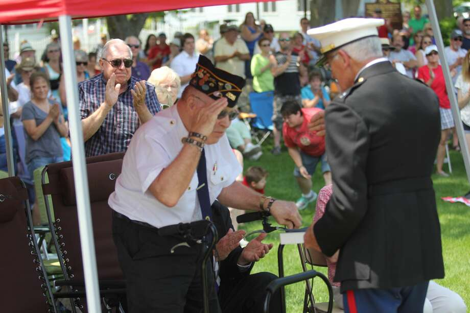 These are scenes from Port Austin's Memorial Day services on Monday. Photo: Mike Gallagher/Huron Daily Tribune