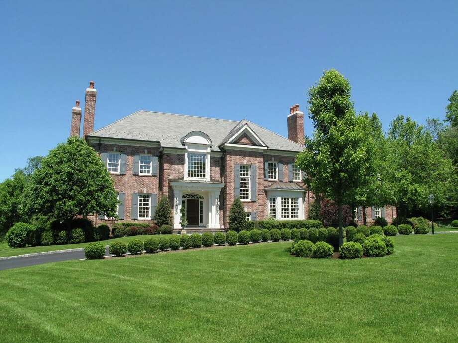 The nearly 10,000-square-foot red brick colonial house at 455 Mansfield Avenue has 15 rooms including six bedrooms.